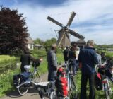 Kinderdijk windmill cyclists