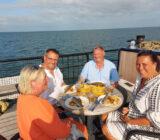 Mare fan Fryslan people eating on deck