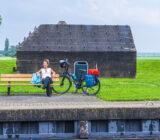 cyclist relaxing near bunker